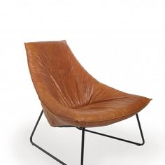 The Beal Easy Chair, designed by Jess Design Team, has a triangular arc frame wrapped in stunning cognac leather upholstery. The natural finish steel frame combines angular lines and rounded edges to match the geometric shape of the chair. Eames Chairs, Upholstered Dining Chairs, Bar Chairs, Ikea Table Legs, Contemporary Armchair, Sweet Home, Butterfly Chair, Diy Chair, Chairs For Sale