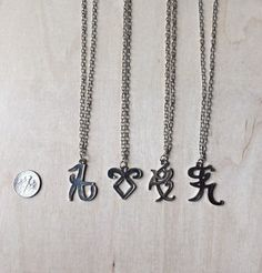 this is a necklace, they are beautiful, are black with gray, are the  runes of series  shadowhunters
