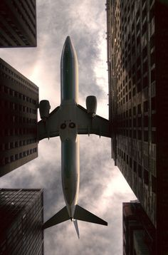 Low, slow flying plane just above the Chicago building scape ~ photography by Kris Brand