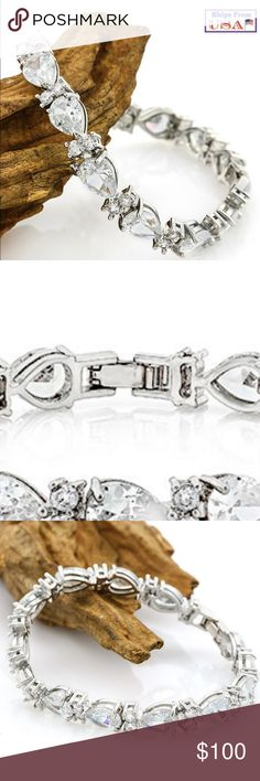 """🎉🎉HOST PICK🎉🎉 WHITE SAPPHIRE TENNIS BRACELET NEW STUNNING 21.9 TCW WHITE SAPPHIRE TENNIS BRACELET!! THE MIX OF TEAR DROP AND ROUND CUT STONES ARE A MUST SEE! SHE IS 18K WHITE GOLD FILLED WEIHS APPROX 18.1 GRANS ABD MEASURES APPROX 7"""" THIS TRUE BEAUTY RETAILS AT $489 TRUE STEAL! Includes velvet gift box ELITE JEWELRY Jewelry Bracelets"""