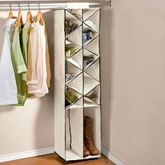 """Shoe/Boot Organizer. has 16 pockets to hold 14 pairs of shoes and 2 pairs of boots neatly in your closet. 5""""Hx14""""Wx12""""D."""