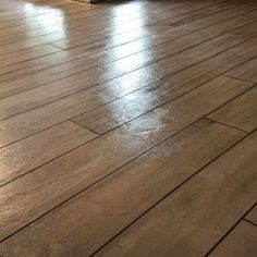 Smooth White Concrete Overlay Stained with Charcoal Antiquing Stain & Sealed with High Gloss, Water-Based Acrylic Sealer Stained Concrete Porch, Concrete Wood Floor, Faux Wood Flooring, Concrete Overlay, Concrete Color, Painting Concrete, Diy Flooring, White Concrete, Stain Concrete