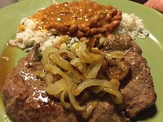 My Puerto Rican aunt taught me her classic bistec recipe. The combination of caramelized onions w/ marinated bistec filet make for one mouthwatering combo. Bistec Encebollado Puerto Rican Recipe, Bistec Recipe, Puerto Rican Cuisine, Puerto Rican Recipes, Traditional Puerto Rican Food, Rice With Beans, Meat Recipes, Cooking Recipes, Steak And Onions