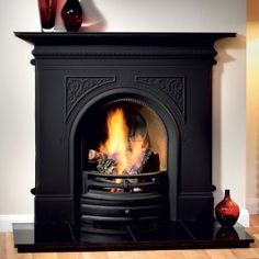 Old ugly gas fire is gone but do I replace it or just block up the hole....this is so pretty!