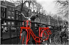Bicycles are everywhere in Amsterdam. The air stays cleaner,as it is situated on the North Sea. Gas prices are higher there then in the States. Bicycle bells ring & it's just beautiful. I once saw a girl riding her bike, in the rain, talking on her cell, holding am umbrella, smoking a cig while riding in heels! Pic from The Tripptist, Amsterdam~ OhLaLaMag