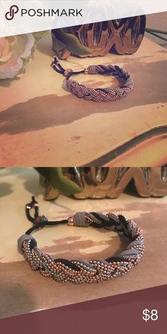 Jessica Simpson bracelet! Jessica Simpson bracelet! Braided with copper and silver beads. Also black and grey suede straps woven in. Jessica Simpson Jewelry Bracelets