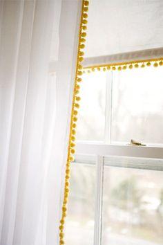 pompom trim added to the edge of pre-made curtains