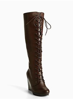 """<div>Start the season off on a whole new level. These chocolate brown faux leather tall boots mean business with a combat-inspired lace up front. The we-have-lift-off wedge takes your look to new heights.</div><div><ul><li style=""""LIST-STYLE-POSITION: outside !important; LIST-STYLE-TYPE: disc !important"""">4.5"""" wedge with 0.5"""" platform</li><li style=""""LIST-STYLE-POSITION: outside !important; LIST-STYLE-TYPE: disc !important"""">Man-made materials</li><li style=""""LIST-STYLE-POSITION: outside…"""
