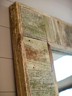Old fencing material, reclaimed from a property along the May River in Bluffton, S.C., finds new life as a mirror frame. The precious heart pine showcases a natural patina, the result of more than 40 years of exposure to salt air, moisture and sunshine.
