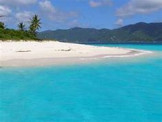 The aqua color of the water is unbelievable, and the white sand.