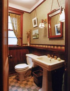 This Chicago bath has a historical feel done up in a dark wood wainscot and checkerboard floor. Art and mirror hang from a picture molding, a nice detail. Photo by Christopher Lark. Craftsman Style Bathrooms, Bungalow Bathroom, Craftsman Interior, Bathroom Red, Bathroom Ideas, Craftsman Houses, Ikea Bathroom, Downstairs Bathroom, Bathroom Designs