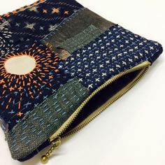 Recycled denim as accessory pouches.