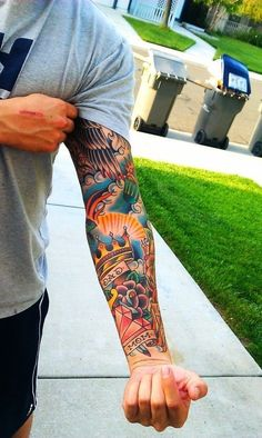 Awesome American Traditional sleeve! Like the flow of this one and colors #TattooIdeasMensSleeve