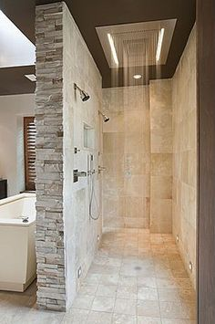 add a bench, a few more side jets. and glass wall, not brick, to see into the bathroom
