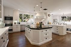 Traditional Kitchen with Soapstone counters, Hardwood flooring, U-shaped, Breakfast bar, Inset cabinets, Kitchen island