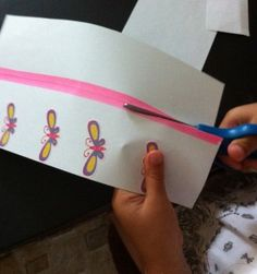 To move hand when cutting: to teach hand placement /movement when cutting. Space out stickers along the edge of a paper and instruct to cut and move non dominant hand to one sticker at a time from bottom to top.