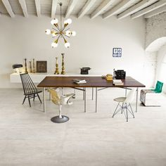Polished concrete effect porcelain interior flooring for creating a contemporary feel. Subtle shades have the appearance & texture of polished concrete. Concrete Tiles, Travertine Floor Tile, Limestone Flooring, Flooring, Travertine Floors, Stone Flooring, Porcelain Flooring, Porcelain Tile, Home Decor