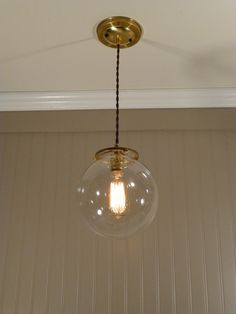CLOSEOUT! Brass Pendant Light with 8 inch Glass Globe $50