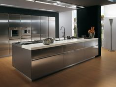 """Here we bring to you a collection of """"21 Awesome Stainless Steel Kitchen design Ideas"""" for your inspiration. Do not forget to share the post as it might also help others. Enjoy!"""