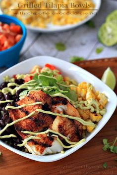 Grilled Tilapia Bowls with corn, black beans, and an amazing Chipotle Avocado Crema. SOOO GOOD!