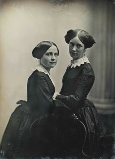 A terrifically fine daguerreotype, it is artistically posed and full of life. What self-possessed young women! The one on the left is wearing a tabard basque.