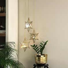 (C) Morataara | Home decor Ideas | Decoration Inspiration #homedecor #homedecorationideas #festivaldecorationideas #lights #festivelights #glasslanterns #interiordecorideas #interiordecorationlights Star Lanterns, Hanging Lanterns, T Lights, Ceiling Lights, Baby Silhouette, Dramatic Effect, Diwali Gifts, Festival Decorations, Frosted Glass