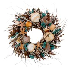 """Our 16"""" Seashell & Dried Floral Wreath is filled with orange star fish, fan shells, orange scallop shells, aqua colored phalaris, chocolate colored oats, and natural beach grass."""