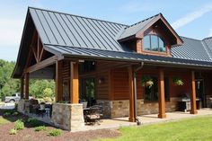 A standing seam metal roof has the advantage of looking rustic or sleek and modern, depending on the building style. Brick Ranch Houses, Metal Roof Houses, House Roof, Black Metal Roof, Metal Roof Colors, Roof Styles, House Styles, Residential Metal Roofing, Standing Seam Roof