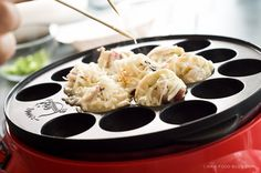I don't know if I'll ever spring for a takoyaki pan (or take the trouble when there sushi place down the street makes such awesome takoyaki), but it's a yummy thought to entertain :)