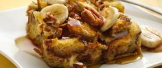 French toast gets a tasty twist with the addition of bananas, rum extract and pecans. The use of cinnamon bread is ideal!
