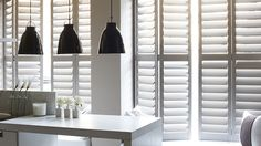 White kitchen with white shutters on the windows White Shutters, Interior Shutters, Window Shutters, Shutter Images, Louvre Windows, Victorian Windows, Kelly Hoppen, Shutter Blinds, Exposed Brick