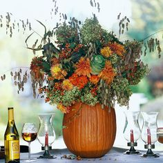 Use a large pumpkin to create a show-stopping centerpiece! More halloween centerpieces: http://www.bhg.com/halloween/indoor-decorating/quick-clever-halloween-centerpieces/?socsrc=bhgpin091413pumpkinbouquet#page=24