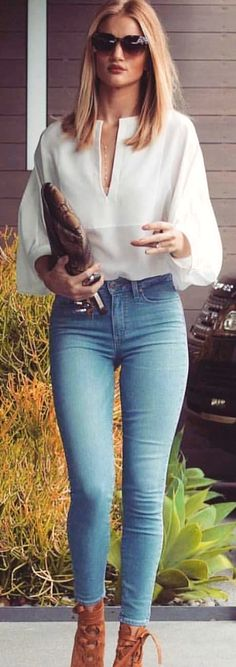 #winter #outfits  white v-neck long-sleeved shirt and blue jeans. Pic by @_luxury_fashion_style.
