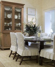 i love the idea of slipcovered dining room chairs