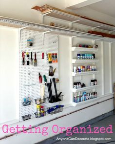 Anyone Can Decorate: Custom Garage Organizer on a Budget rain gutter, garag organ, spray, paint cans, garages, organizers, paints, shelv, custom garag