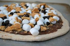 S'mores dessert pizza on the Grill. Perfect for summertime BBQs, this easy dessert will be a huge hit with family and friends. Must try!
