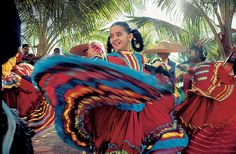 Mexican dancer with a multi color skirt