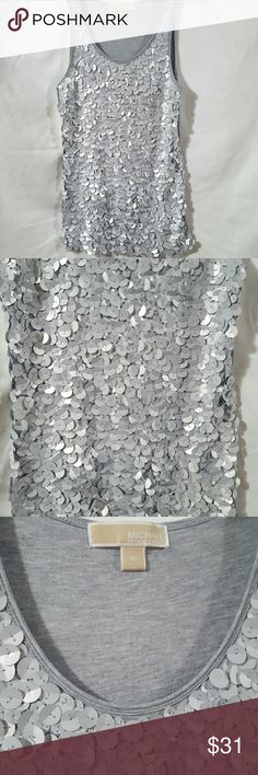 NWOT Michael Kors sequin tank NWOT Fun & Fabulous night & day tank, excellent quality, stunning hand sewn flat grey sequin, fabric stretches, 100% Rayon, hand wash inside out, lay flat to dry.  16' from armpit to armpit, 25' in length.    Please ask any and all questions before purchasing this item Michael Kors Tops Tank Tops