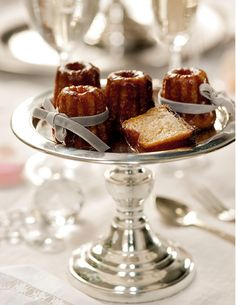 A canelé is a small French pastry with a soft and tender custard center and a dark, thick caramelized crust. The dessert, which is in the shape of small, striated cylinder approximately two inches in height, is a specialty of the Bordeaux region of France