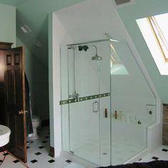 Bathroom with slanted ceilings.