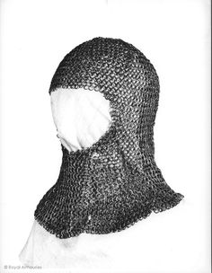 Mail coif c.1331-1370, Royal Armouries, Leeds  Constructed of alternate rows of flat riveted and solid rings. The rivets of the riveted links are wedge-shaped, with domed heads 1.78 mm across. There is a vertical opening at the rear, and at the lower rear is a triangular section of the same mail fitted with the rivet heads on the inside, possibly a working-life modification.