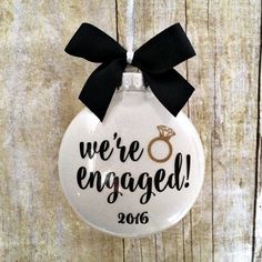 "Wedding Gift Engagement Ornament, Engaged Ornament, Personalized Engagement Gift, Engagement… - This beautiful ""We're Engaged Ornament"" features a sparkly white glitter background with modern black Engagement Ornaments, Wedding Ornament, Christmas Engagement Photos, Christmas Gifts For Couples, Christmas Proposal, Christmas Time, Christmas Bulbs, Vinyl Christmas Ornaments, Festivus"