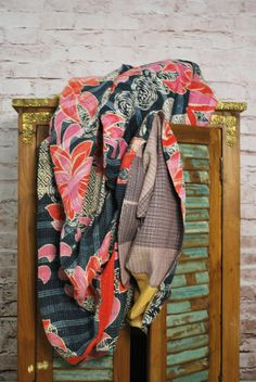 This vibrant and colorful vintage sari kantha throw instantly brightens and refreshes your space. Meticulously handcrafted by skilled artisans