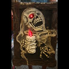 Gothic Light-up ZOMBIE SKELETON PORTRAIT Walking Dead Decor Halloween Party Prop. Dimensional Haunted House Picture with Lighted Candle Lamp Realistic Flame Bulb. Eyes Flicker! Horror Movie Night Haunt Wall Hanging Cemetery Graveyard Crypt Decor. http://www.horror-hall.com/Halloween-Prop-LIGHT-UP-ZOMBIE-SKELETON-PORTRAIT-Gothic-Decor-HH-SS-AM629.htm