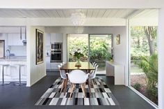 Contemporary Dining Room with Black And White Rug