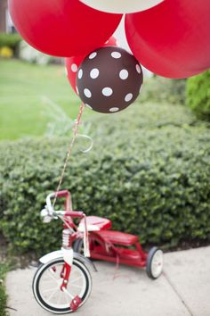 balloons tied to tricycle