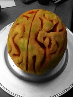 Watermelon BRAIN- peel rind.  Use wooden skewer or any other tool to carve your brain. I set this out on a table halloween night! Halloween fav!!! Trick or treat!