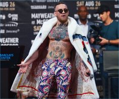 Taking to Brooklyn, New York, Conor McGregor wears David August multicolored pants with a fur coat.