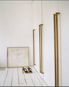 """Long handles  From Abigail Ahern's website """"I transformed simple MDF doors by designing super long handles which I made from oak strips from the DIY store. Wish this was gold on black or pink"""