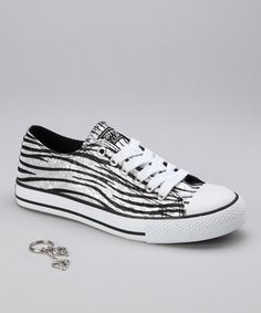 Step up that street cred clad in these stylish sneaks. Zebra stripes against a shimmery backing add a pop of pizzazz to any casual-chic ensemble.
